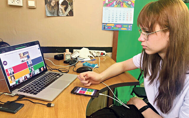 Student Karina Smirnova in St Petersburg takes part in the ORT Day quiz