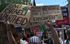 """A placard quotes the words of IRA terrorist Bobby Sands who said that Ireland's revenge on the UK will be the """"laughter of our children""""."""