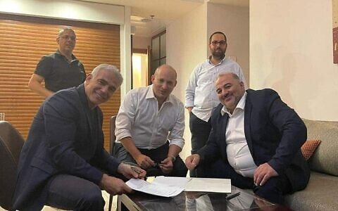 Yair Lapid, Naftali Bennett and Mansour Abbas were among eight party leaders who agreed the coalition deal. (Photo: Twitter)