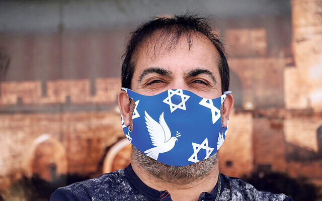 Man wearing a face mask decorated with the Jewish Star of David due to the COVID-19 coronavirus pandemic