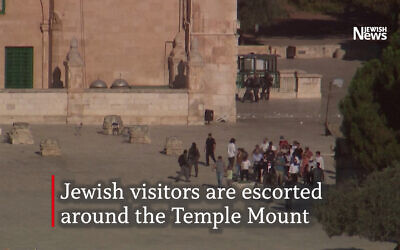 Jewish visitors under police escort at the Temple Mount (Photo: Reuters)