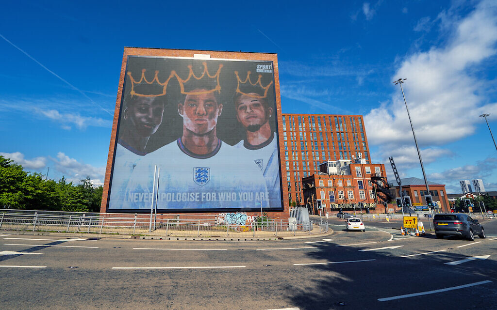 A digital mural of England players Marcus Rashford, Jadon Sancho and Bukayo Saka in Manchester.