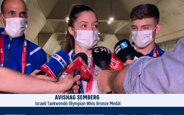 Avishag Semberg speaking to the press after winning a bronze medal (Screenshot from i24 News.)