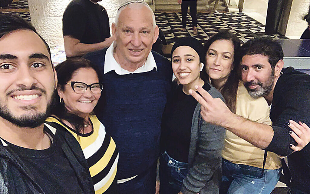 Gina and Amram Maman, second and third from left, with Aysha Abu Shhab, fourth from left, along with other recuperating guests at the Dan Jerusalem hotel