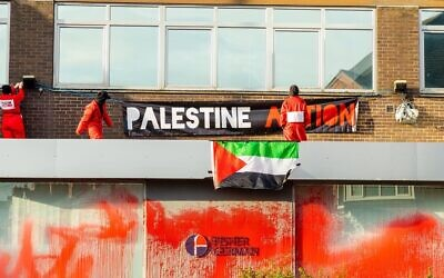 Activists on top of the building in Birmingham (Credit: Palestine Action on Twitter)