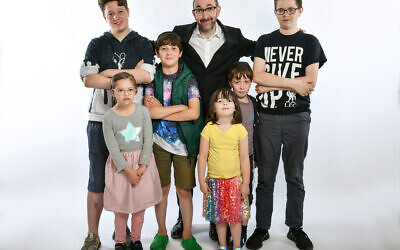 Ashley Blaker with his brood of half a dozen children, three of whom have special needs