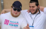 L-R: Yechiel Yosef Rothschild, also known as YY, with friend and carer Hershy Weiss, who died in a plane crash on Wednesday