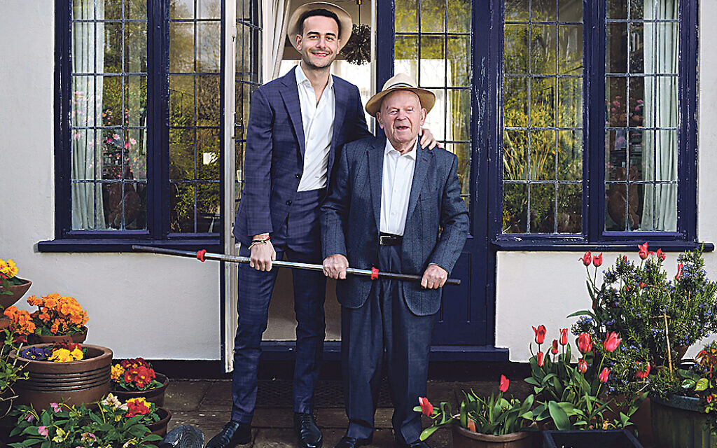 Sir Ben Helfgott with his grandson Sam. Ben was a champion weightlifter after he arrived in the UK. Credit: Frederic Aranda