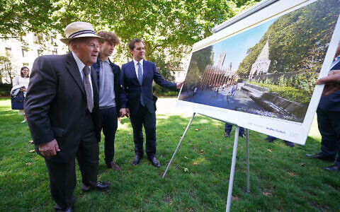 Housing Secretary Robert Jenrick (right), holocaust survivor Sir Ben Helfgott and his grandson Reuben at Victoria Gardens in Westminster, London, celebrating the go-ahead being given to a Holocaust memorial. Picture date: Thursday July 29, 2021.