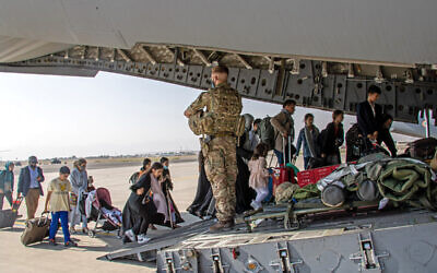MoD handout photo of British citizens and dual nationals residing in Afghanistan being relocated to the UK, as part of Operation PITTING, the UK Armed Forces are enabling the relocation of personnel and others from Afghanistan. Issue date: Monday August 16, 2021.