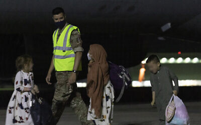 IMAGE BLURRED AT SOURCE Ministry of Defence handout photo of passengers disembarking a Royal Air Force Voyager after arriving at RAF Brize Norton from the Middle East. Boris Johnson and other G7 leaders have failed to persuade the US to keep troops in Afghanistan to continue evacuation efforts past the end of the month. Picture date: Tuesday August 24, 2021.