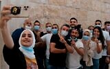 Palestinian residents of Sheikh Jarrah take a selfie on Monday before attending a petition regarding evacuation from their home in Sheikh Jarrah neighborhood, at the Supreme Court