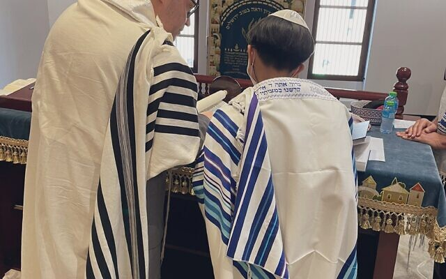 The bar mitzvah boy, who was not named, read from a Torah scroll commissioned by Jared Kushner (Photo: Association of Gulf Jewish Communities)