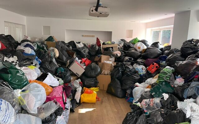 Black bags with donated items were piled high