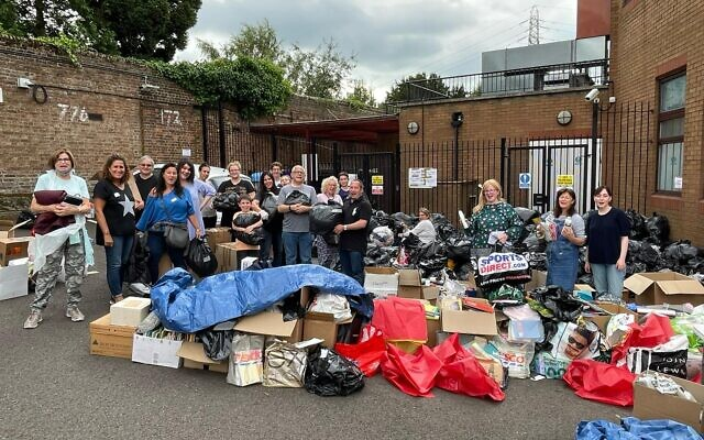 Volunteers with bags of donated items at Bushey synagogue