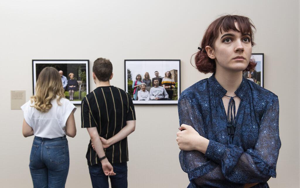 Visitors explore Generations: Portraits of Holocaust Survivors at IWM London. © IWM