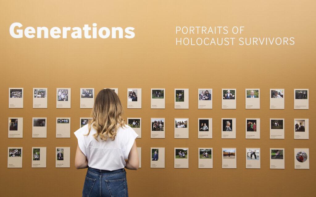 © IWM (1471) A visitor explores Generations: Portraits of Holocaust Survivors at IWM London.