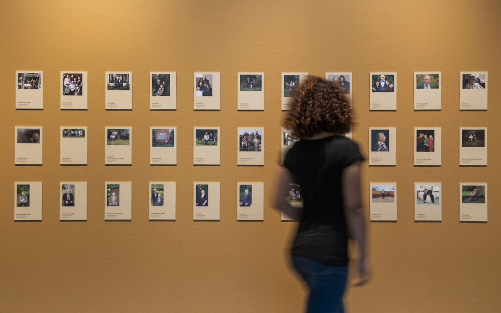 © IWM (1571) A visitor explores Generations: Portraits of Holocaust Survivors at IWM London.