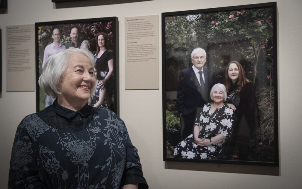 Joan Salter MBE sits alongside her portrait by Frederic Aranda, exhibited at IWM London as part of Generations: Portraits of Holocaust Survivors.© IWM