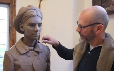 Artist Ian Wolter with a figure for the Kindertransport Memorial