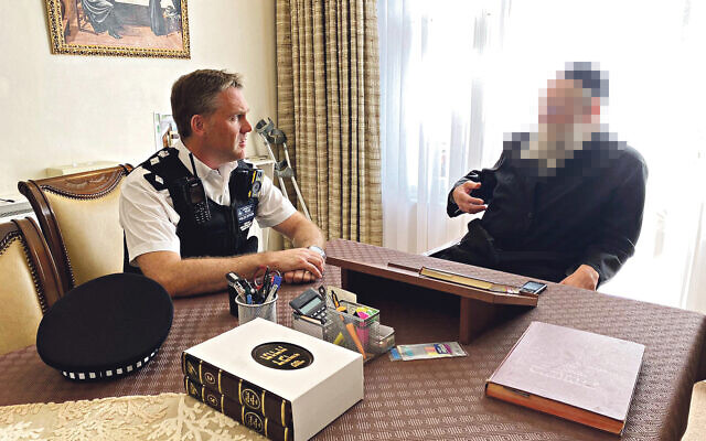 Jacob Lipchitz in his home with  MPS Hackney  Chief Supt Barnett, and members of Shomrim