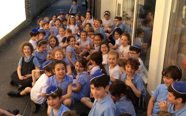 Year 2 pupils at Sacks Morasha in the school playground
