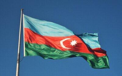 Azerbaijan's flag (Photo by Hikmat Gafarzada on Unsplash)