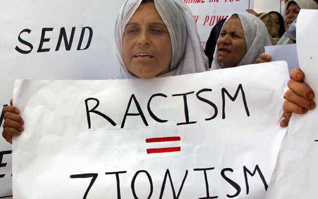 A Palestinian woman carries a banner during a demonstration in the Gaza Strip on September 5, 2001, ahead of the UN conference in Durban, South Africa (Photo: Reuters/Ahmed Jadallah)