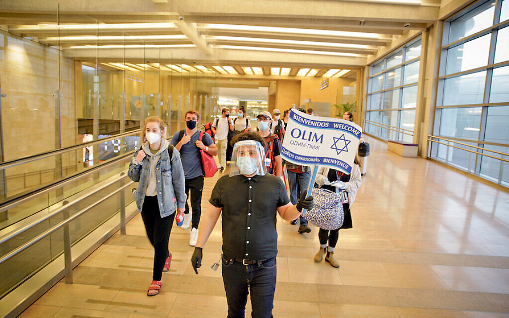 New arrivals: Olim at Israel's Ben-Gurion airport this year