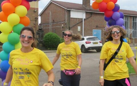 Juliet Berman, left, organised the Pulse Challenge, a 20-mile walk from London to Hertfordshire, in memory of her daughter, Shani, five, who died in 2017 from a congenital heart defect