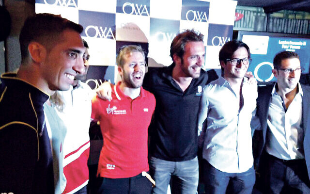 Oliver, right, with F1 team drivers, is raising awareness of health and nutrition through esports