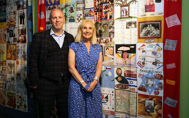 Rob Rinder MBE and Angela Cohen MBE (Chairman of the '45 Aid Society) next to the '45 Aid Society Memory Quilts at the Loughton Boys exhibition at Epping Forest District Museum on Sunday 5th September (credit: Melissa Page)