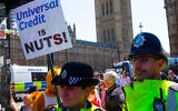 Universal Credit protestors march to the Houses of Parliament with the slogan Universal Credit is nuts Credit: Tim Ring/Alamy Live News