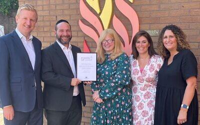 L-RL Oliver Dowden MP, Rabbi and Rebbetzen Feldman, and volunteers Deborah Dobrin and Melanie Barnett