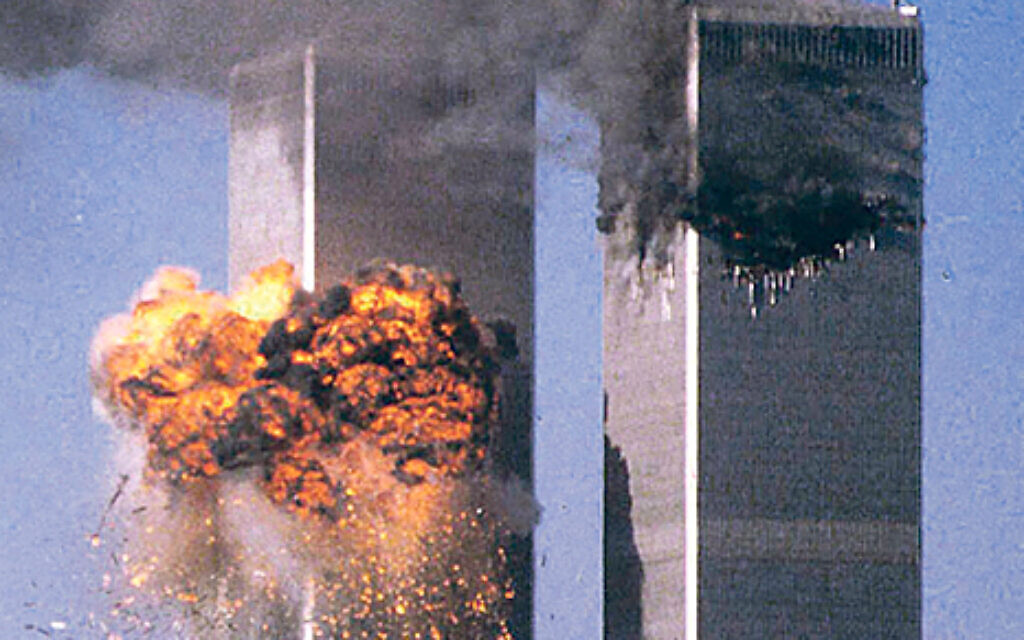 United Flight 175 crashes into the south tower (L) of the World Trade Center in New York as the north tower burns after being hit by American Flight 11 a short time earlier, in this file photo from September 11, 2001. This year's anniversary of the September 11 attacks in New York and Washington will echo the first one, with silence for the moments the planes struck and when the buildings fell, and the reading of 2,792 victims' names. REUTERS/Sean Adair-Files  HB/