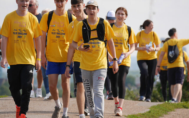 More than a hundred brightly dressed walkers put their best feet forward and raised £50,000 in memory of five-year-old Shani Berman, from Elstree, who died from a rare heart condition
