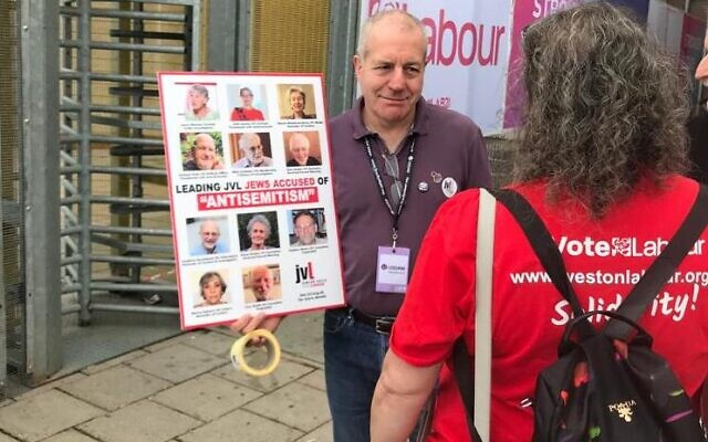 'Gary', a member of JVL protests outside the conference