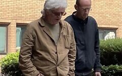 Piers Portman, right, leaves court with conspiracy theorist Matthew Delooze, left.   credit: Campaign Against Antisemitism