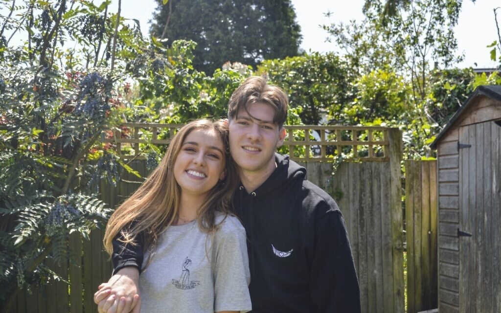 Joe with girlfriend Jess wearing his merchandise. They met via the podcast