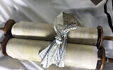 A Torah scroll that the Nazis stole from a Czech congregation on display at The Memorial Scrolls Trust in London. (Courtesy of the European Union for Progressive Judaism)