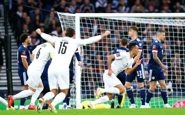 Israel's Eran Zahavi (right) celebrates scoring their side's first goal of the game during the FIFA World Cup Qualifying match at Hampden Park, Glasgow. Picture date: Saturday October 9, 2021.