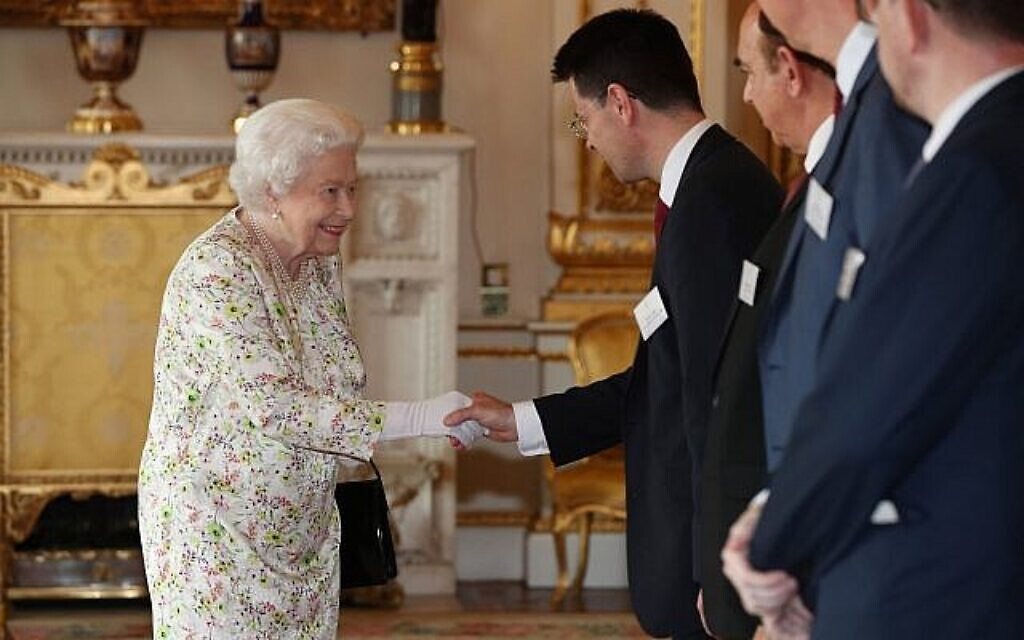 Queen Elizabeth II greets Housing Secretary James Brokenshire during a reception at Buckingham Palace, London, to celebrate the work of UK faith and belief groups in bringing local communities together. Photo credit: Jonathan Brady/PA Wire