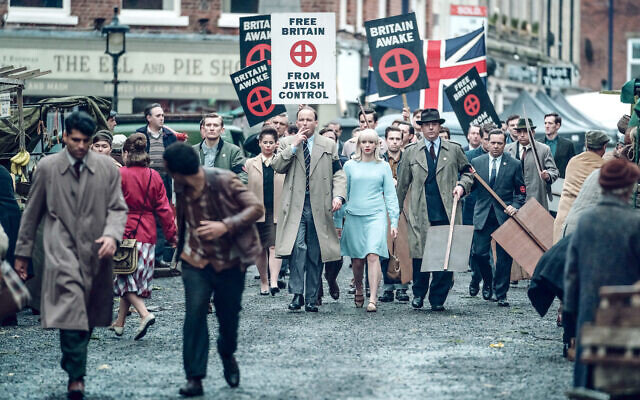 Scene from Ridley Road shows Colin Jordan (Rory Kinnear), Vivien Epstein (Agnes O'Casey) marching towards a Synagogue.- (C) Red Productions - Photographer: Ben Blackall