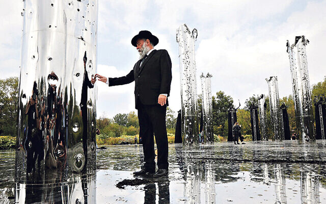 A visitor to the installation Crystal Wall of Crying, in memory of the massacre at Babyn Yar