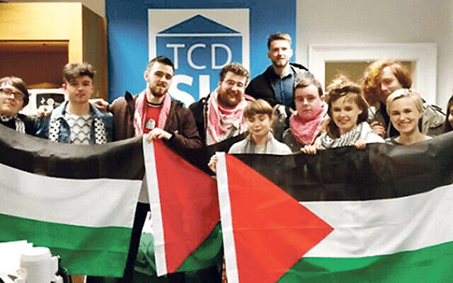 Members of the Trinity BDS Campaign holding Palestinian flags (Source: Algemeiner.com)