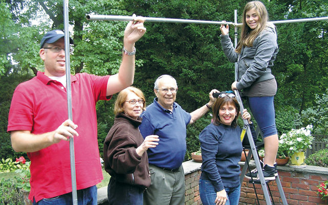 Bonim volunteers built a sukkah for an elderly couple who cannot put it up themselves.