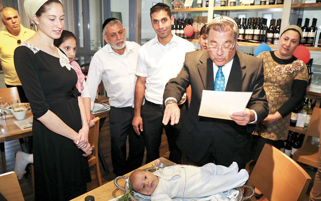 Rabbi Shlomo Riskin, rabbi of Efrat, conducts a pidyon haben ceremony for a 30-day-old firstborn son there last month.