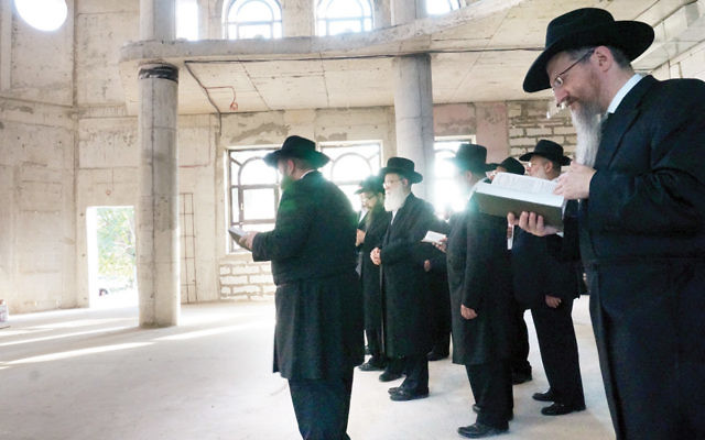 Russian Chief Rabbi Berel Lazar, right, with Chabad rabbis at an unfinished synagogue in Sevatopol, Crimea, in July 2014.