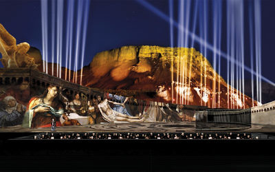 """Mount Masada shimmers in the night sky as the stage is set for 'Tosca."""""""
