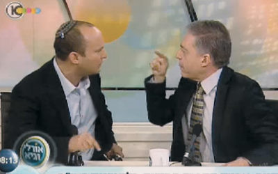 Yossi Beilin, right, debates with Naftali Bennett of the Jewish Home Party in a 2012 television appearance.